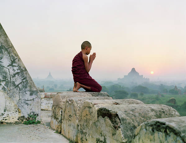 Child Poster featuring the photograph Myanmar, Bagan, Buddhist Monk Praying by Martin Puddy