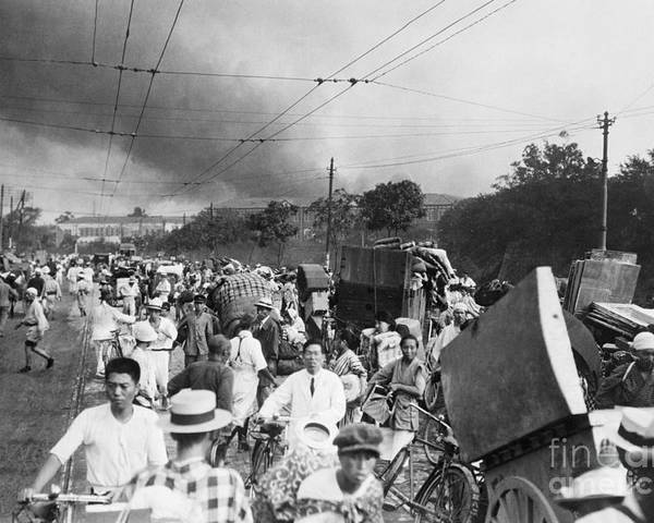 Crowd Of People Poster featuring the photograph Residents Flee Tokyo After Earthquake by Bettmann