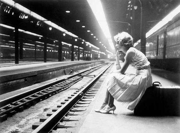 Child Poster featuring the photograph Teenage Girl Waiting For Train by Bettmann