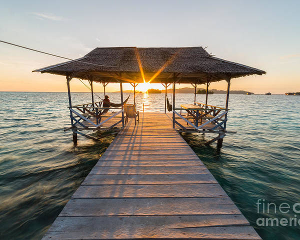 Dusk Poster featuring the photograph Tourist Sitting On Wooden Jetty While by Fabio Lamanna