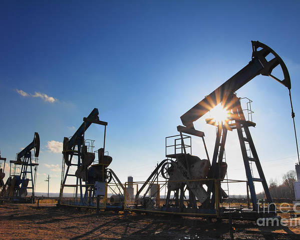 Steel Poster featuring the photograph Working Oil Pumps Silhouette Against Sun by Kokhanchikov