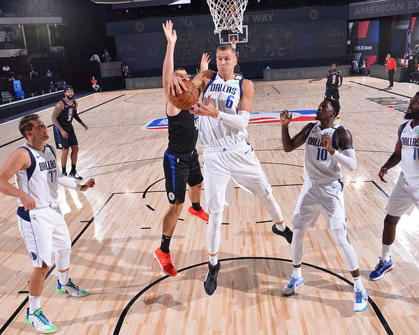 Playoffs Poster featuring the photograph Dallas Mavericks v LA Clippers - Game One by David Sherman