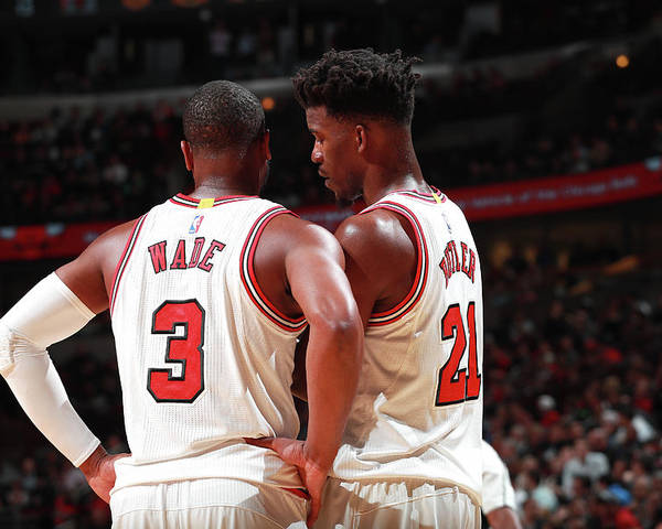 Nba Pro Basketball Poster featuring the photograph Jimmy Butler and Dwyane Wade by Jeff Haynes