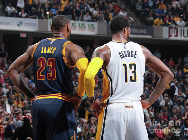Playoffs Poster featuring the photograph Paul George and Lebron James by Ron Hoskins