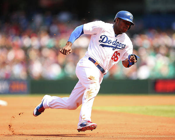 Los Angeles Dodgers Poster featuring the photograph Yasiel Puig by Brendon Thorne