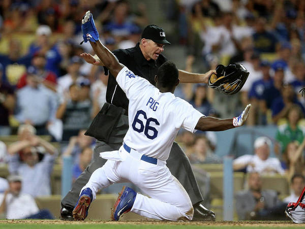 People Poster featuring the photograph Yasiel Puig by Stephen Dunn