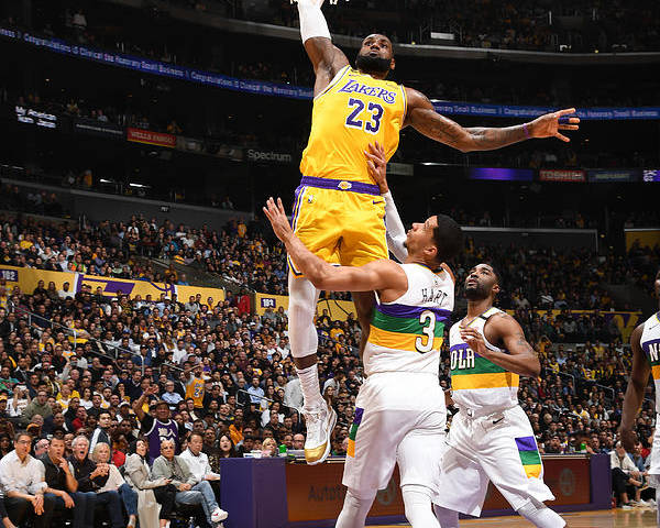 Nba Pro Basketball Poster featuring the photograph Lebron James - Tribute to Kobe by Andrew Bernstein