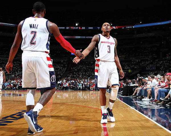 Playoffs Poster featuring the photograph John Wall and Bradley Beal by Ned Dishman