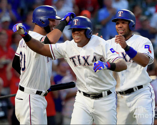Adrian Beltre Poster featuring the photograph Adrian Beltre, Elvis Andrus, and Nomar Mazara by Tom Pennington