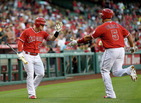 People Poster featuring the photograph Albert Pujols and Kole Calhoun by Harry How