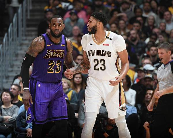 Nba Pro Basketball Poster featuring the photograph Anthony Davis and Lebron James by Andrew D. Bernstein