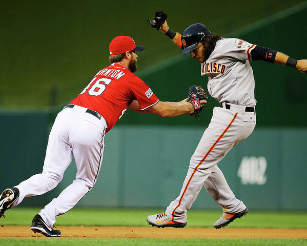 National League Baseball Poster featuring the photograph Brandon Crawford and Matt Thornton by Al Bello