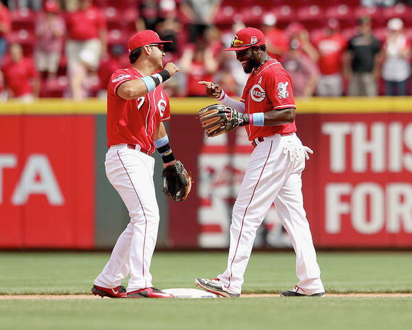 Great American Ball Park Poster featuring the photograph Brandon Phillips and Eugenio Suarez by Andy Lyons