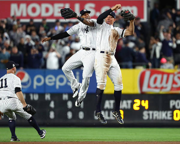 Playoffs Poster featuring the photograph Brett Gardner, Aaron Judge, and Aaron Hicks by Al Bello