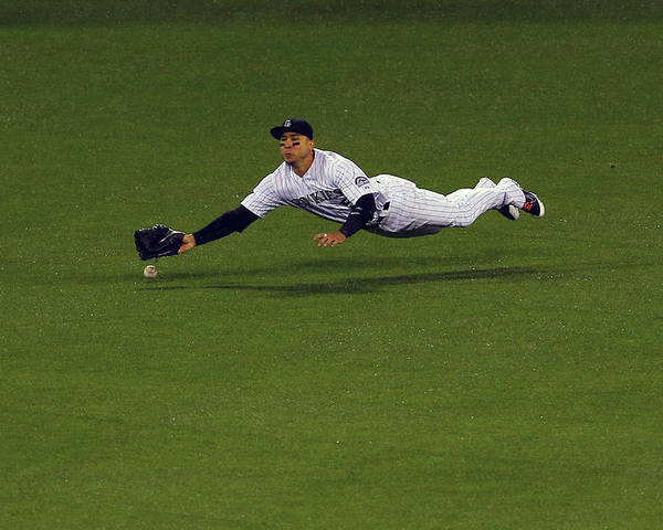 Carlos Gonzalez - Us Baseball Player Poster featuring the photograph Carlos Gonzalez and Adrian Gonzalez by Justin Edmonds
