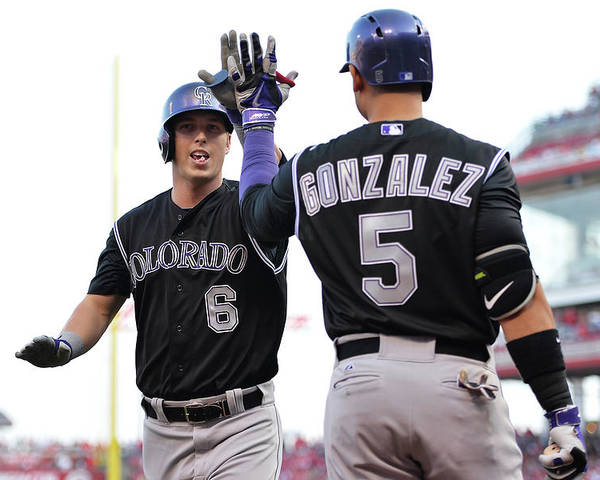 Great American Ball Park Poster featuring the photograph Carlos Gonzalez and Corey Dickerson by Jamie Sabau