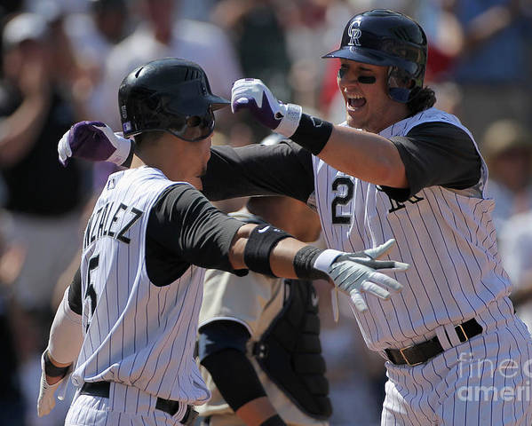Scoring Poster featuring the photograph Carlos Gonzalez and Troy Tulowitzki by Doug Pensinger