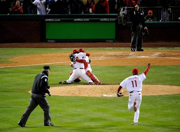 Baseball Catcher Poster featuring the photograph Carlos Ruiz, Brad Lidge, and Jimmy Rollins by Jeff Zelevansky