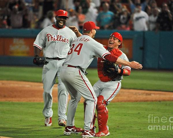 Carlos Ruiz Poster featuring the photograph Carlos Ruiz, Ryan Howard, and Roy Halladay by Ronald C. Modra