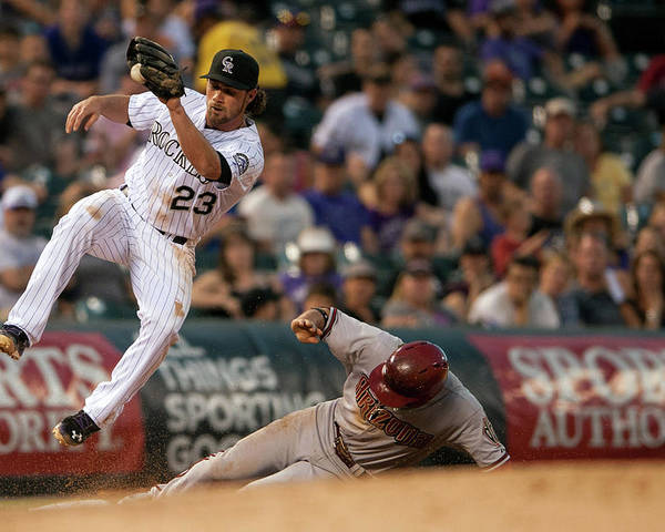 Catching Poster featuring the photograph Charlie Culberson And Martin Prado by Dustin Bradford