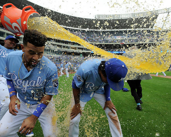 Salvador Perez Diaz Poster featuring the photograph Cheslor Cuthbert and Raul Mondesi by Ed Zurga