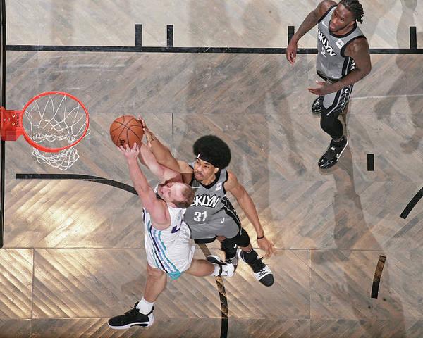 Nba Pro Basketball Poster featuring the photograph Cody Zeller and Jarrett Allen by Nathaniel S. Butler