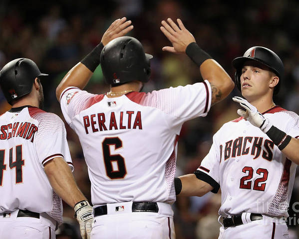 People Poster featuring the photograph David Peralta, Paul Goldschmidt, and Jake Lamb by Christian Petersen