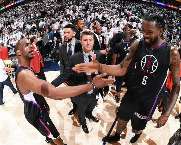 Playoffs Poster featuring the photograph Deandre Jordan and Chris Paul by Andrew D. Bernstein