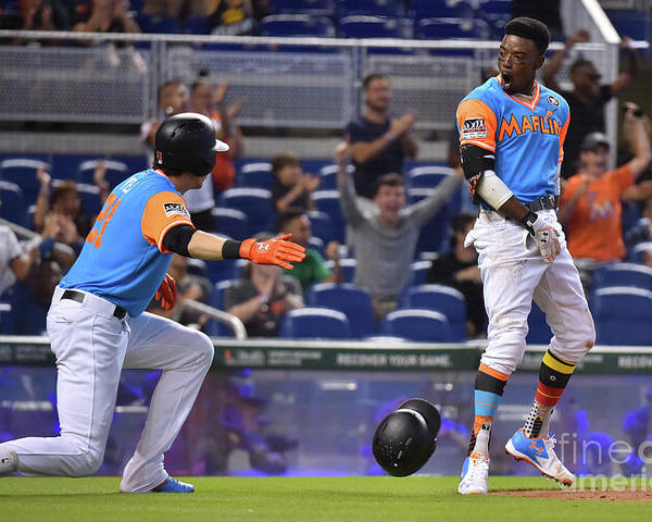 People Poster featuring the photograph Dee Gordon And Christian Yelich by Eric Espada