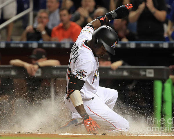 People Poster featuring the photograph Dee Gordon and Giancarlo Stanton by Mike Ehrmann
