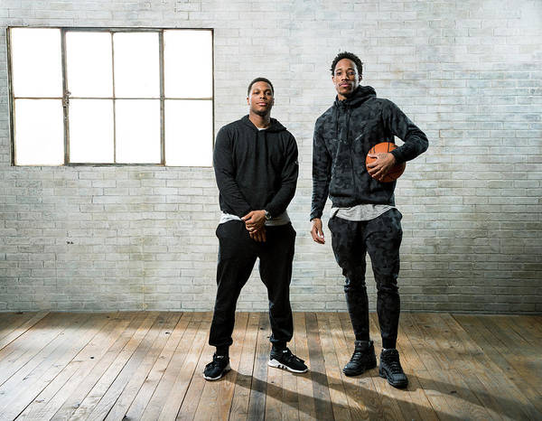 Nba Pro Basketball Poster featuring the photograph Demar Derozan and Kyle Lowry by Nathaniel S. Butler