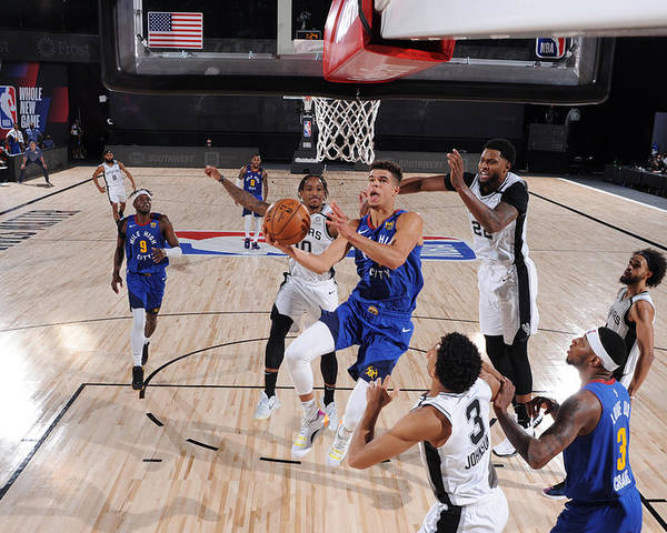 Nba Pro Basketball Poster featuring the photograph Denver Nuggets v San Antonio Spurs by Garrett Ellwood