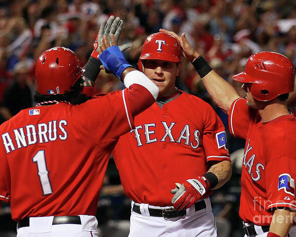 Playoffs Poster featuring the photograph Elvis Andrus, Michael Young, And Josh Hamilton by Stephen Dunn