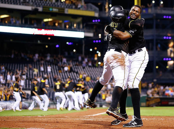 People Poster featuring the photograph Francisco Cervelli and Gregory Polanco by Jared Wickerham