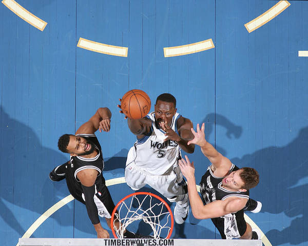 Nba Pro Basketball Poster featuring the photograph Gorgui Dieng by David Sherman