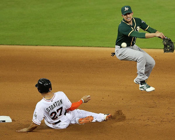 Double Play Poster featuring the photograph Jed Lowrie and Giancarlo Stanton by Mike Ehrmann