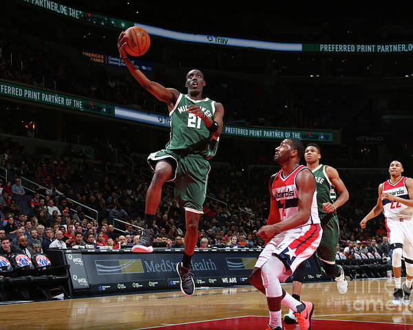 Nba Pro Basketball Poster featuring the photograph John Wall and Tony Snell by Ned Dishman