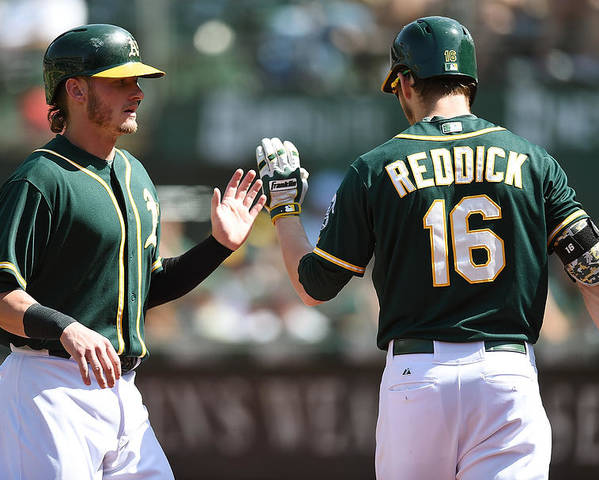 Ninth Inning Poster featuring the photograph Josh Reddick and Josh Donaldson by Thearon W. Henderson