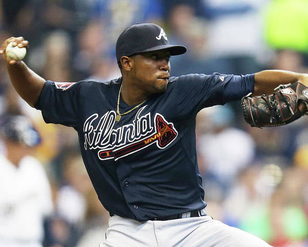 Julio Teheran Poster featuring the photograph Julio Teheran by Mike Mcginnis
