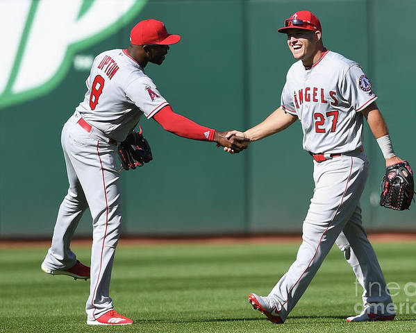 American League Baseball Poster featuring the photograph Justin Upton and Mike Trout by Thearon W. Henderson