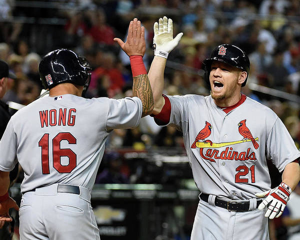 St. Louis Cardinals Poster featuring the photograph Kolten Wong and Brandon Moss by Norm Hall