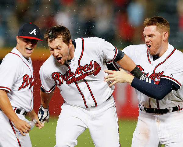 Atlanta Poster featuring the photograph Kris Medlen, Freddie Freeman, and Chris Johnson by Kevin C. Cox