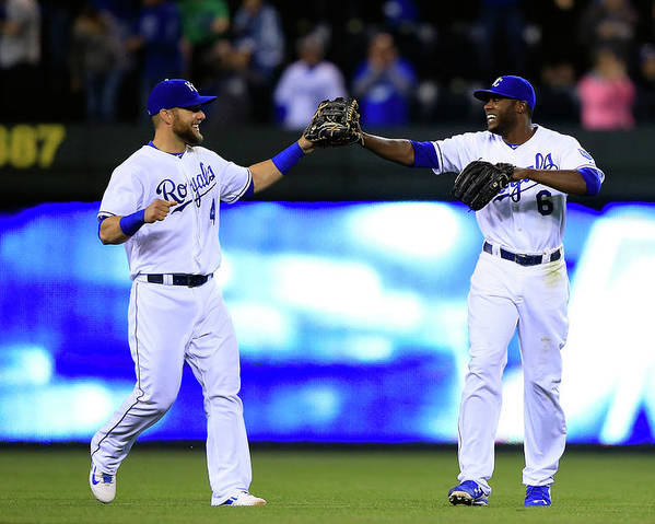 American League Baseball Poster featuring the photograph Lorenzo Cain and Alex Gordon by Jamie Squire