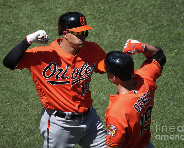 People Poster featuring the photograph Manny Machado and Chris Davis by Tom Szczerbowski