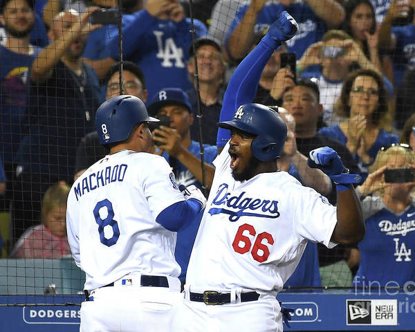 Three Quarter Length Poster featuring the photograph Manny Machado and Yasiel Puig by Jayne Kamin-oncea