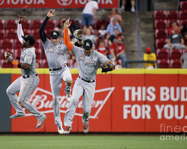 Great American Ball Park Poster featuring the photograph Marcell Ozuna, Christian Yelich, and Giancarlo Stanton by Joe Robbins