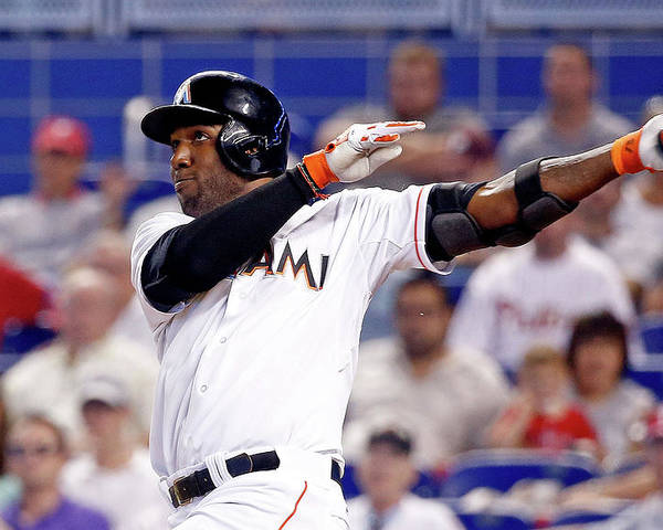 American League Baseball Poster featuring the photograph Marcell Ozuna by Rob Foldy