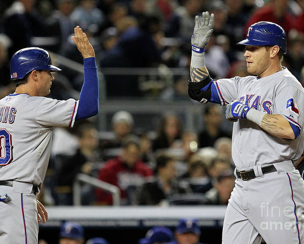 Playoffs Poster featuring the photograph Michael Young and Josh Hamilton by Al Bello