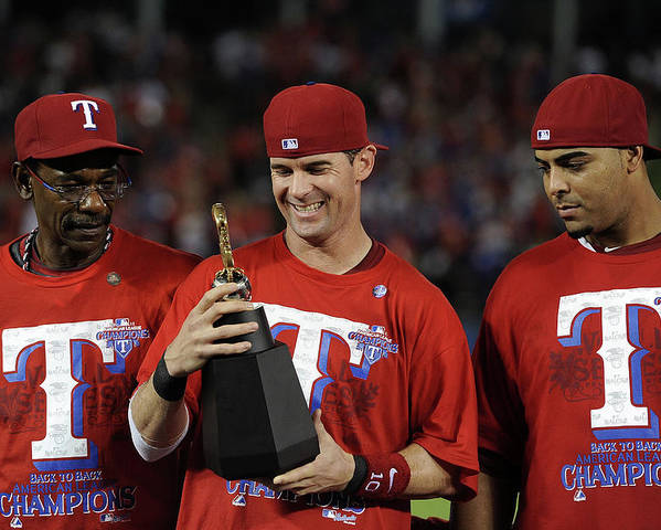 American League Baseball Poster featuring the photograph Michael Young, Nelson Cruz, and Ron Washington by Harry How