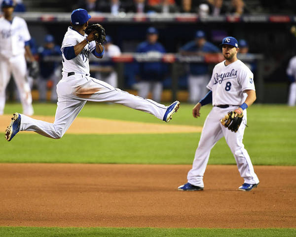 Playoffs Poster featuring the photograph Mike Moustakas and Alcides Escobar by Rob Tringali